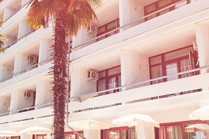 hotel for recreation during tourism and travel. retro style. palm trees in the tropics