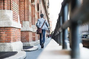 Mature businessman walking in a city.