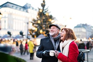 Senior couple on an outdoor Christmas market.