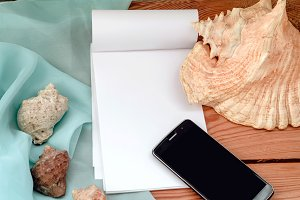 seashells. notebook and phone for business ideas