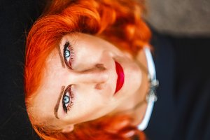 Portrait of a woman. Red hair. blue eyes