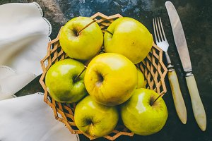 Apples on a plate, autumn harvest.