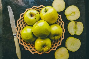 fruit. Apples on a plate. Knife for slicing
