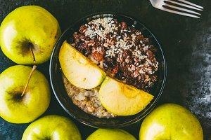 Apples and raisins on oatmeal. Healthy breakfast