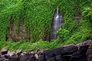 Waterfall on mossy rocks, Bali beach