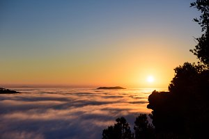 Scenic sunset above the clouds