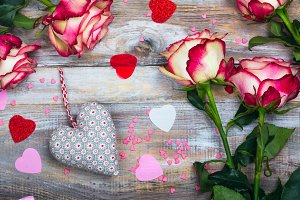 Roses and hearts on wooden background. Valentines day or mothers day greeting card