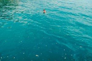 Man floats in sea water