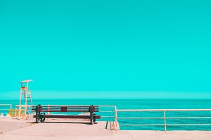 Clear sky, calm sea. Bench