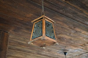 Ceiling lamp on the wooden ceiling