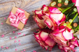 Beautiful roses on wooden background. Valentines day or mothers day greeting card