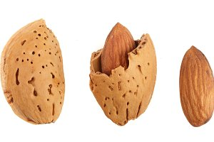 almonds are peeled and unpeeled isolated on white background without a shadow close up. Top view