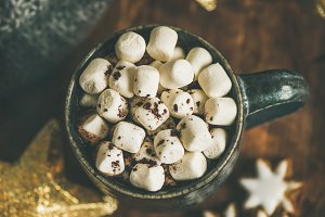 Christmas winter hot chocolate with marshmellows served with light garland