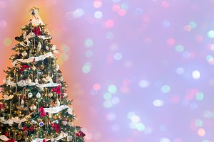 Decorated christmas tree against wide background