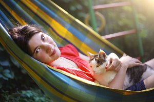teen girl in hammock with cat close up s