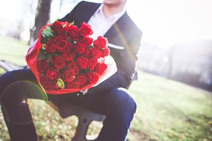 Gentleman with Roses in a Park #1