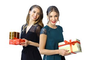 two fashon models in formal clothes with presents close up photo