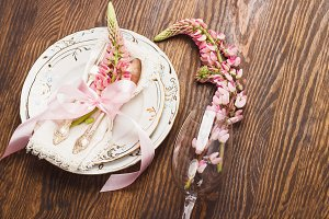 Tableware with pink lupines and silverware