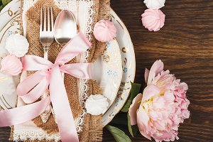 Tableware with light pink peonies and meringues