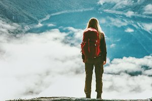 Traveler woman wander above clouds