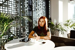 red-haired business woman in cafe