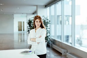 Business woman in white office shirt