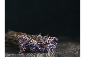 Bunch of lavender flowers on brown wooden table