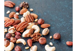 mix of cashew, pecan, pine nuts, hazelnuts on blue