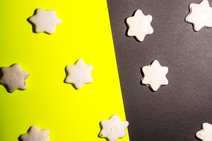 cookies in the form of stars. feast for the feast. background is black and yellow.