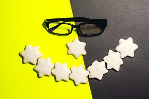 smile from a cookie. food. glasses for sight.