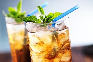 iced tea in glass with blue straw