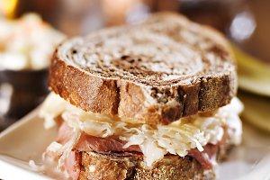 reuben sandwich on wooden table