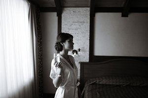 Beautiful bride girl with a glass of