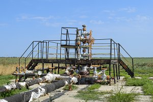 Well for oil and gas production. Oil well wellhead equipment. Oil production