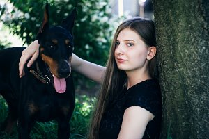 A girl in a park with a dog