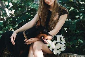Young girl with dog Doberman
