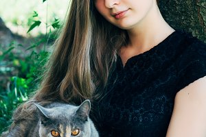 Young is a beautiful girl with a British cat
