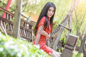 Asian Smile girl with red qipao