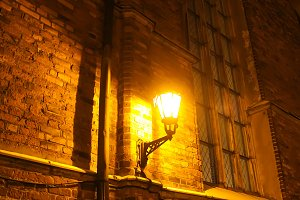 Streetlight. Lantern on brick wall