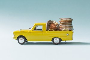 Stack of coins in yellow car