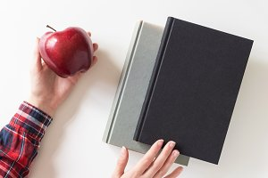 Girl student holding apple and book
