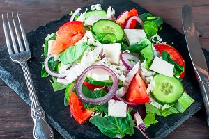 A mixed salad with cucumber, tomatoe