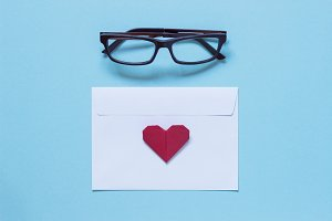 Eyeglasses, white envelope, heart