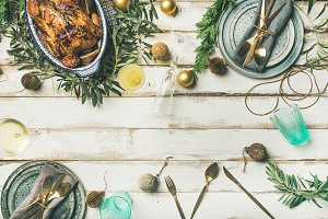 Christmas or New Year celebration table setting, wide composition