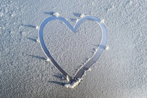 heart drawn in the frost on the hood of the car
