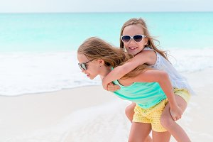 Adorable little girls during summer vacation. Kids enjoy their travel