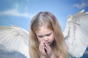 Little girl angel with wings