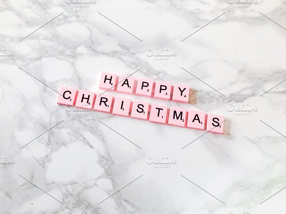 Happy Christmas in pink letters in Product Mockups