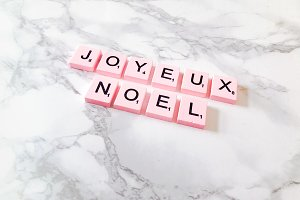 French pink Happy Christmas on desk