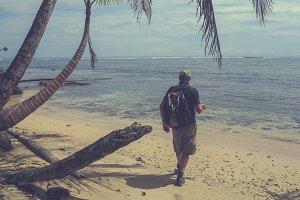 Man on deserted tropical beach